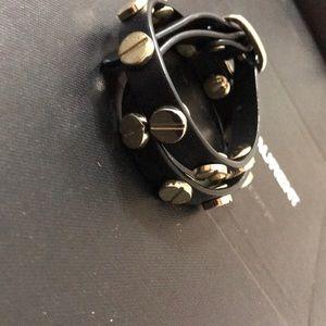 Black & gold detailed wrap around bracelet.